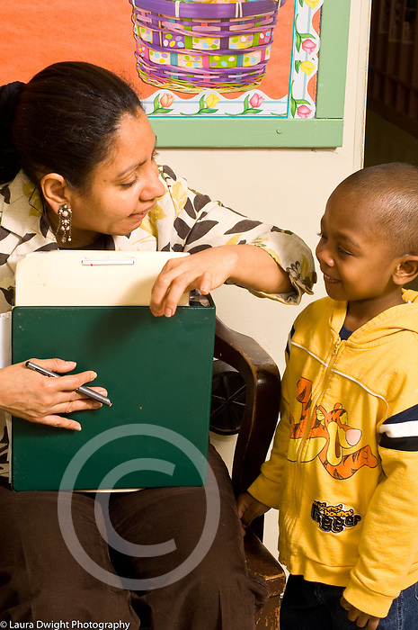 Education day care female teacher and boy talking