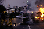 Brixton Riots. South London Uk April 1981. Firemen attend a burning car set on fire by the rioters.