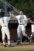 Michael Turconi (4) (Wake Forest) of the High Point-Thomasville HiToms bumps helmets with teammate Jack Hennessy (7) (USC-Upstate) after hitting a home run against the Statesville Owls at Finch Field on July 19, 2020 in Thomasville, NC. The HiToms defeated the Owls 21-0. (Brian Westerholt/Four Seam Images)
