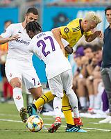 Christian Koffi #27 and Mesut Ozil #10 battle for the ball