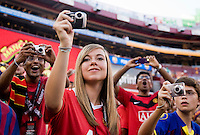 Manchester United fans take pictures of their team as they take the field during the friendly at FedEX Field in Landover, MD.  Manchester United defeated FC Barcelona, 2-1.