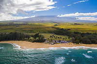 Aerial view of Maui's Baldwin Beach in Pa'ia, with Haleakala in the distance.