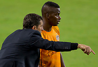 CARSON, CA - OCTOBER 28: Tab Ramos head coach the Houston Dynamo giving his student Darwin Quintero #23 directions during a game between Houston Dynamo and Los Angeles FC at Banc of California Stadium on October 28, 2020 in Carson, California.