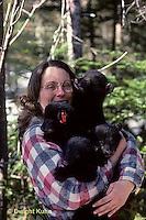 MA01-029z  Black Bear - four cubs being held by wildlife biologist at winter den site  - Ursus americanus