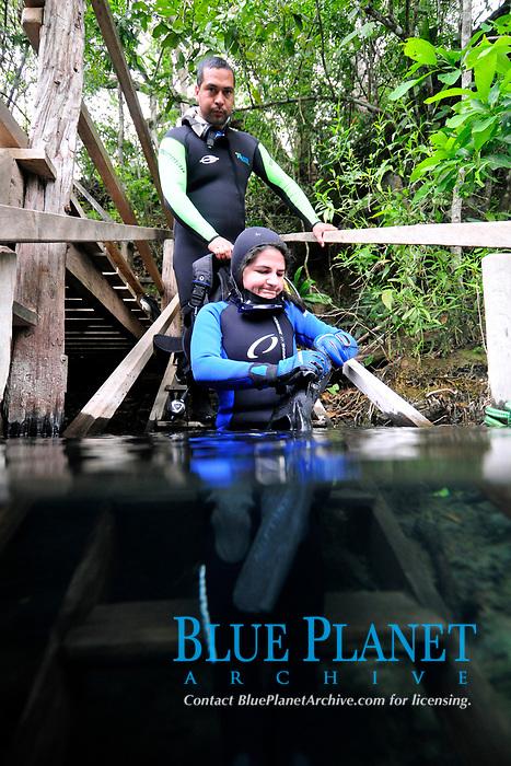 Scuba divers gear up to enter the waters of Prata river, Bonito Mato Grosso do Sul, Brazil