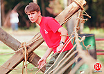 WOLCOTT,CT. 9/26/98--0926SV04.tif--Bryan Reis,14, of Wolcott works on building a rope bridge in Peterson Park in Wolcott on Saturday. The boy scouts were in the park promoting Boy Scout awareness.  Steven Valenti Photo
