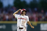 Arkansas infielder Robert Moore (1) reacts as he runs home following a score, Monday, June 7, 2021 in the eighth inning of the NCAA Fayetteville Regional at Baum-Walker Stadium in Fayetteville. Check out nwaonline.com/210608Daily/ for today's photo gallery. <br /> (NWA Democrat-Gazette/Charlie Kaijo)