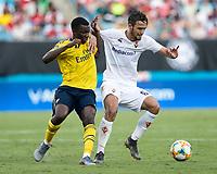 Luca Ranieri #6 holds off Eddie Nketiah #30