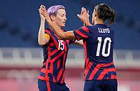 SAITAMA, JAPAN - JULY 24: Megan Rapinoe #15 and Carli Lloyd #10  of the United States celebrate during a game between New Zealand and USWNT at Saitama Stadium on July 24, 2021 in Saitama, Japan.