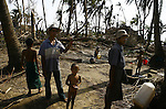 Cyclone Nargis survivors stand in the village of Kamingo, at the Irrawaddy Division, May 10, 2008. Despairing survivors in Myanmar awaited emergency relief on Friday, a week after 100,000 people were feared killed as the cyclone roared across the farms and villages of the low-lying Irrawaddy delta region. The storm is the most devastating one to hit Asia since 1991, when 143,000 people were killed in neighboring Bangladesh. Photo by Eyal Warshavsky  *** Local Caption *** ëì äæëåéåú ùîåøåú ìàéì åøùáñ÷é àéï ìòùåú áúîåðåú ùéîåù ììà àéùåø