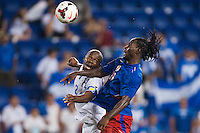 Honduras defender Osman Chavez (2) goes up for a header with Haiti forward Leonel Saint Preux (18). Honduras defeated Haiti 2-0 during a CONCACAF Gold Cup group B match at Red Bull Arena in Harrison, NJ, on July 8, 2013.