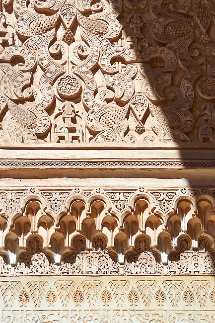 Berber arabesque Morcabe and honeycombe Muqarnas plasterwork of the 14th century Ben Youssef Madersa (Islamic college) re-constructed by the Saadian Sultan Abdallah al-Ghalib in 1564 as the largest and most prestigious Medersa in Morocco. Marrakesh, Morroco