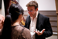 Jury member Sylvain Blassel from France speaks with performer Esther Yoon Chung after the Composition Forum at the 11th USA International Harp Competition at Indiana University in Bloomington, Indiana on Monday, July 8, 2019. (Photo by James Brosher)