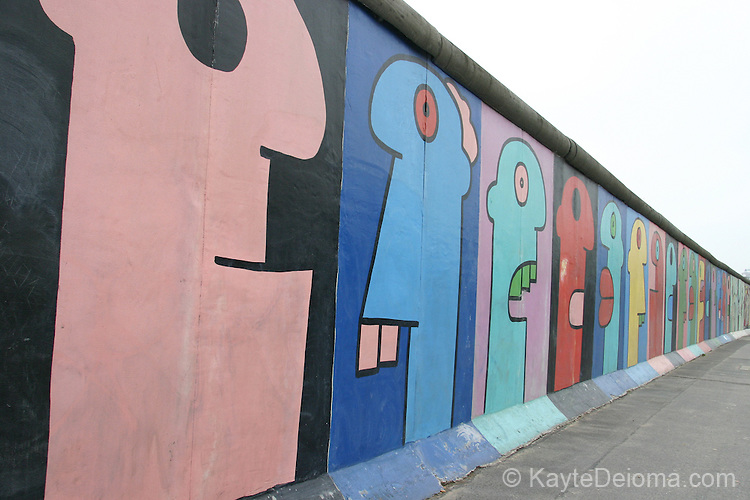 Eastside Gallery.  118 artists from around the world painted murals on the longest remaining piece of the Berlin wall in 1990.  Berlin, Germany
