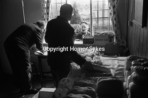 Chulkhurst Charity. Biddenden, Kent 1975. On Easter Monday a loaf of bread, a pound of tea and a pound of cheese is given to qualifying pensioners and the widows of Biddenden.