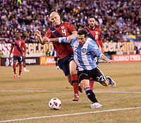Michael Bradley (4) of the United States fights for the ball with Ezequiel Lavezzi (22) of Argentina during an international friendly at New Meadowlands Stadium in East Rutherford, NJ.  The United States tied Argentina, 1-1.