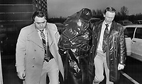 1980 File -<br /> <br /> Faces masked by garbage bags; three suspects in the pistol-whipping; $148;716 robbery of Canada Trust in Scarborough arrive at 41 division police station to take part in a line-up.<br /> <br /> Photo : Boris Spremo - Toronto Star archives - AQP