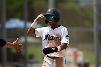 GCL Marlins Nasim Nunez (1) is congratulated by teammates after scoring a run during a Gulf Coast League game against the GCL Cardinals on August 12, 2019 at the Roger Dean Chevrolet Stadium Complex in Jupiter, Florida.  GCL Marlins defeated the GCL Cardinals 9-2.  (Mike Janes/Four Seam Images)