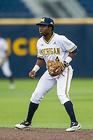 Michigan Wolverines second baseman Ako Thomas (4) on defense against the Oakland Golden Grizzlies on May 17, 2016 at Ray Fisher Stadium in Ann Arbor, Michigan. Oakland defeated Michigan 6-5 in 10 innings. (Andrew Woolley/Four Seam Images)