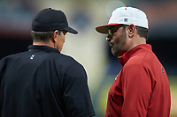 Louisiana Ragin' Cajuns head coach Tony Robichaux (right) listens as home plate umpire Brennan Breaux explains a call during the game against the Mississippi State Bulldogs in game three of the 2018 Shriners Hospitals for Children College Classic at Minute Maid Park on March 2, 2018 in Houston, Texas.  The Bulldogs defeated the Ragin' Cajuns 3-1.   (Brian Westerholt/Four Seam Images)