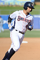 Tennessee Smokies third baseman Greg Rohan #8 rounds the bases after homering during game one of a double header against the  Pensacola Blue Wahoos at Smokies Park on July 30, 2012 in Kodak, Tennessee. The Smokies won both ends of the double header 6-3 in game one and 3-2 in game two. (Tony Farlow/Four Seam Images).