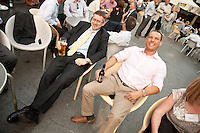 Eddie Williams and Rob Russell both of PWC take a quick break from networking