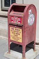 A mailbox style deposit box for disposal of used or worn American Flags stands outside the post office in Yonkers, New York.