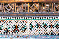 Fes, Morocco.  Medersa Bou Inania, Decorative Tile and Woodwork.