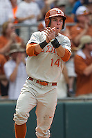 Texas Longhorns outfielder Ben Johnson (14) celebrates after scoring a run in the fifth inning of the NCAA baseball game against the Houston Cougars on June 6, 2014 at UFCU Disch–Falk Field in Austin, Texas. The Longhorns defeated the Cougars 4-2 in Game 1 of the NCAA Super Regional. (Andrew Woolley/Four Seam Images)