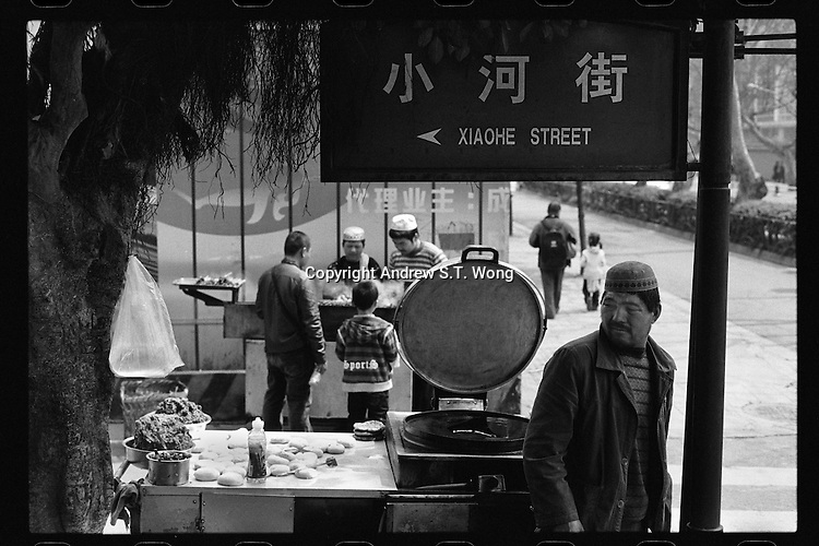 Chinese Muslim vendors sell food outside the Huangcheng Mosque in Chengdu, capital city of the southwestern province of Sichuan, in March, 2011.