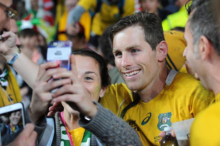 Bernard Foley of Australia has a selfie taken by a Wallabies' fan after Match 35 of the Rugby World Cup 2015 between Australia and Wales - 10/10/2015 - Twickenham Stadium, London<br /> Mandatory Credit: Rob Munro/Stewart Communications