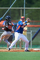 New York Mets first baseman Dash Winningham (35) throws to second as Isaiah White (68) runs through the bag during an Instructional League game against the Miami Marlins on September 29, 2016 at the Port St. Lucie Training Complex in Port St. Lucie, Florida.  (Mike Janes/Four Seam Images)