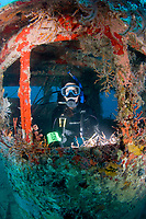 Diver Sara Brookes exploring the wreck of the M/V Corinthian, a tugboat, St. Kitts, Caribbean.
