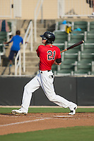 Louie Lechich (21) of the Kannapolis Intimidators follows through on his swing against the Delmarva Shorebirds at CMC-Northeast Stadium on June 7, 2015 in Kannapolis, North Carolina.  The Shorebirds defeated the Intimidators 9-1.  (Brian Westerholt/Four Seam Images)