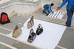 Venice Italy 2009.North African man selling fake DESIGNER HANDBAGS.