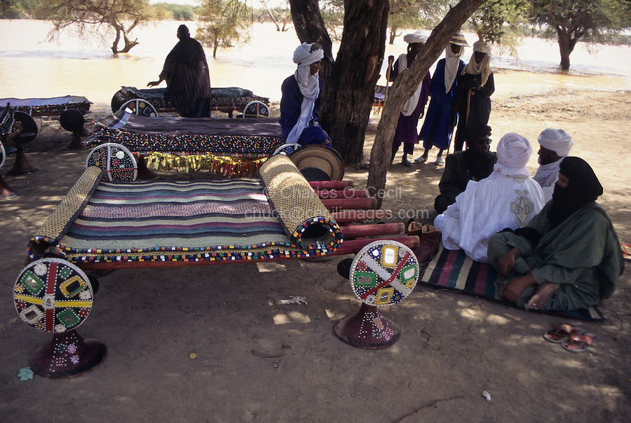 Akadaney, Central Niger, West Africa.  Fulani Nomads.  Portable Bed with Mats on Top, Men Talking.