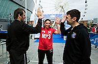10 AUG 2014 - LIVERPOOL, GBR - Team Liverpool MPs team members Shadow Secretary of State for Health Andy Burnham (left), Shadow Minister for Public Health, Luciana Berger (centre) and, former Liverpool mayor Steve Rotherham (right) pose for pictures after the Tri Liverpool triathlon relay in Kings Dock in Liverpool, Great Britain. Burnham finished the swim leg in 20:50, Rotherham completed the bike in 48:26 with Berger giving the team a finish time of 1:51:12 with a 35:45 run (PHOTO COPYRIGHT © 2014 NIGEL FARROW, ALL RIGHTS RESERVED)