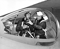 The Photo squadron personal, planes, and cameras equipment. Instruction on using an Eyemo camera in a PBY blister camera should be support by a tripod as shown.