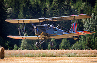 De Havilland DH-82A Tiger Moth II Coming in to land in a field. <br /> <br />  Airplanes and reenactors photographed at in connection with Høytorptreffet, an annual event at the Høytorp fort. <br /> <br /> Høytorp fort is a barrage fort in the Glomma defence line, built 1912-17. On April 13th and 14th 1940 the fort was in combat against German army units . It is now protected as a national monument.<br /> <br /> ©Fredrik Naumann/Felix Features