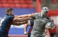 5th February 2021; Ashton Gate Stadium, Bristol, England; Premiership Rugby Union, Bristol Bears versus Sale Sharks; Curtis Langdon of Sale Sharks hands off Jake Woolmore of Bristol Bears