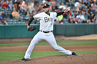 Salt Lake Bees starting pitcher Justin Thomas (10) delivers a pitch to the plate against the Reno Aces at Smith's Ballpark on May 4, 2014 in Salt Lake City, Utah.  (Stephen Smith/Four Seam Images)
