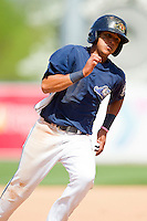 David Gonzalez (18) of the West Michigan Whitecaps rounds third base on his way to scoring a run against the \wc\ at Fifth Third Ballpark on May 5, 2013 in Comstock Park, Michigan.  The River Bandits defeated the Whitecaps 5-4.  (Brian Westerholt/Four Seam Images)