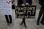 GREENSBORO, NC - NOVEMBER 3:   Ava Olson, center, holds a sign in support of education during a Moral March to the Polls event sponsored by the North Carolina NAACP in Greensboro, NC, on Monday, November 3, 2014.  (Photo by Ted Richardson/For The Washington Post)