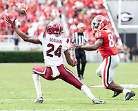 ATHENS, GA - OCTOBER 12: Israel Mukuamu #24 of the South Carolina Gamecocks intercepts a ball intended for Tyler Simmons #87 of the Georgia Bulldogs during a game between University of South Carolina Gamecocks and University of Georgia Bulldogs at Sanford Stadium on October 12, 2019 in Athens, Georgia.