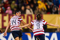 Abby Wambach (14) of the United States (USA) celebrates scoring with Heather O'Reilly (9) during the first half against the Germany (GER) during an international friendly at Rentschler Field in East Hartford, CT, on October 23, 2012.