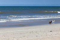 Avon, Outer Banks, North Carolina. Middle-aged Couple Enjoying the Waves on the Beach.