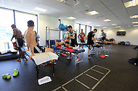 Pictured: Players being examined by physiotherapists. Wednesday 02 July 2014<br /> Re: Pre-season testing during the first day of training for Swansea City FC players at the Landore training ground.