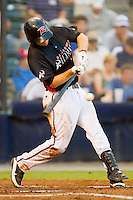 Wes Hodges #18 of the Richmond Flying Squirrels makes contact with the baseball against the Harrisburg Senators in game two of a double-header at The Diamond on July 22, 2011 in Richmond, Virginia.  The Senators defeated the Flying Squirrels 1-0.   (Brian Westerholt / Four Seam Images)