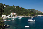 Greece, Corfu, Agni: View of yachts and Tavernas in cove