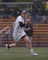 Boston College midfielder Brittany Wilton (11) brings the ball forward. Boston College defeated University of New Hampshire, 11-6, at Newton Campus Field, May 1, 2012.